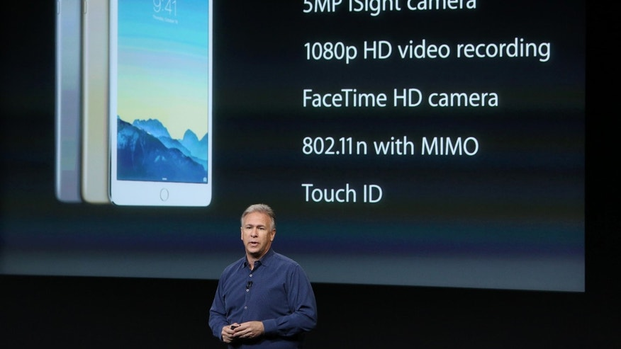 Phil Schiller, Apple's senior vice president of worldwide product marketing speaks during a presentation of the new iPad at Apple headquarters in Cupertino, Calif. Oct. 16, 2014.