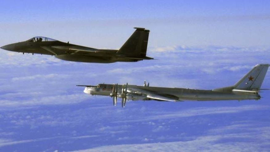 "Sept. 28, 2006: This file photo provided by the U.S. Air Force shows an F-15C Eagle from the 12th Fighter Squadron at Elmendorf Air Force Base in Anchorage, Alaska, flying next to a Russian Tu-95 ""Bear"" bomber, right, during a Russian exercise which brought the bomber near the west coast of Alaska."