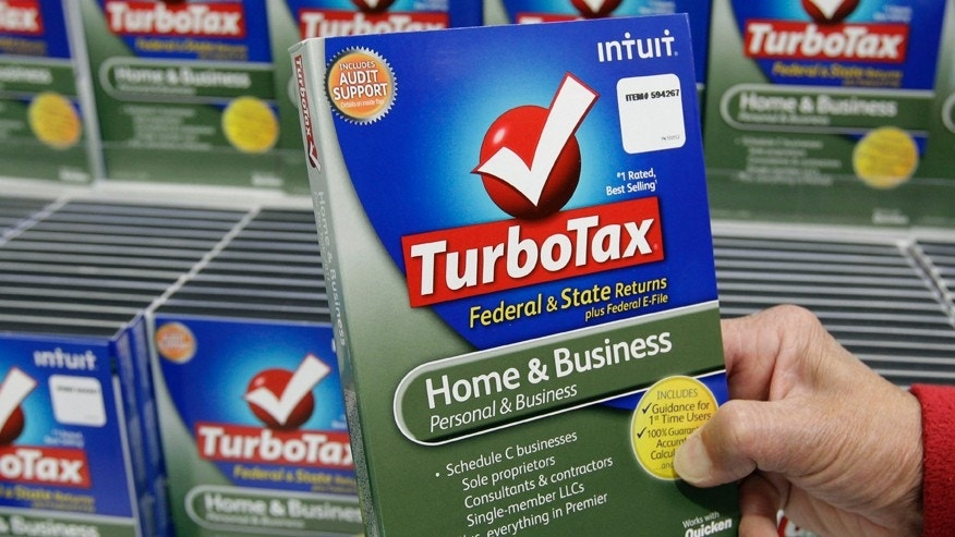 FILE - In this Jan. 24, 2013 file photo, a customer looks at a copy of TurboTax on sale at Costco in Mountain View, Calif.