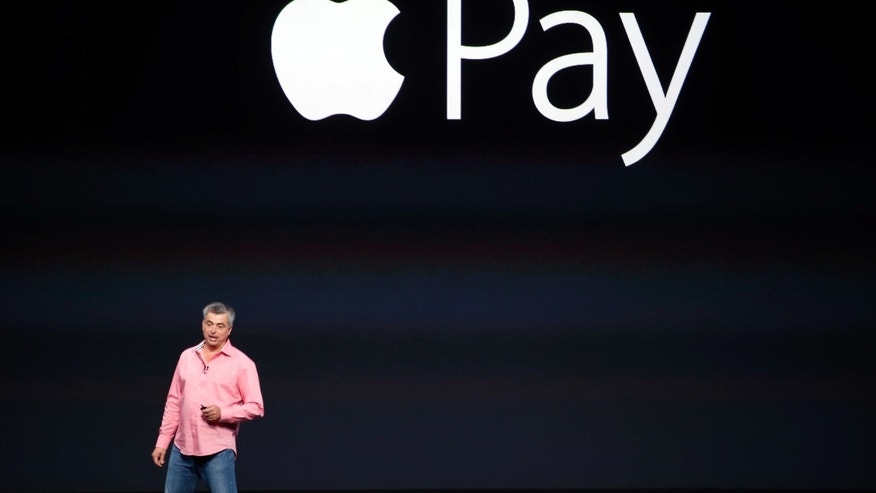 Eddy Cue, Apple;s senior vice president of Internet Software and Service, introduces Apple Pay during an Apple event at the Flint Center in Cupertino, California, September 9, 2014.
