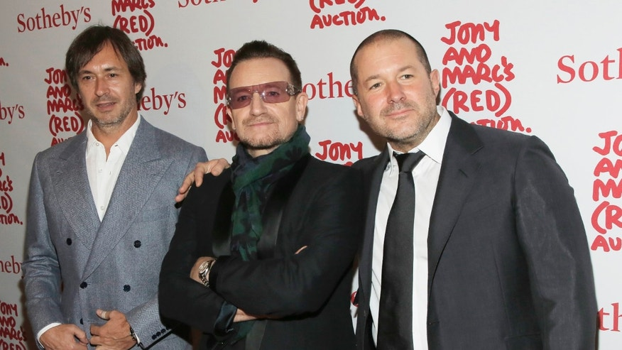 Designer Marc Newson (L), Singer Bono (C) and Apple's Senior Vice President of Design Jony Ive attend Jony And Marc's (RED) Auction at Sotheby's in New York Nov. 23, 2013.