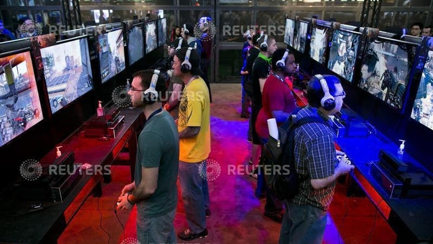 Gaming enthusiasts play video games at the PAX East convention in Boston, Massachusetts, April 12, 2014.