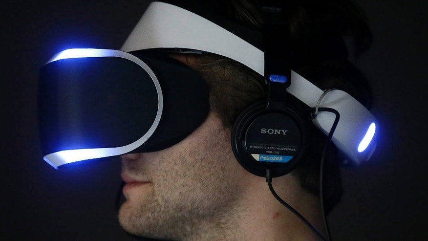 March 19, 2014: Marcus Ingvarsson tests out the PlayStation 4 virtual reality headset Project Morpheus in a demo area at the Game Developers Conference 2014.