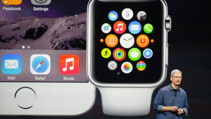 Apple CEO Tim Cook speaks during an Apple event announcing the iPhone 6 and the Apple Watch Sept. 9, 2014.