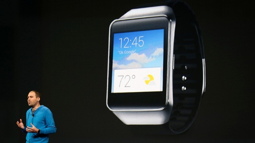 David Singleton, director of engineering for Android, announces a new Samsung Android Wear smartwatch during his keynote address at the Google I/O developers conference in San Francisco June 25, 2014.