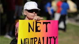 File photo. Lori Erlendsson attends a pro-net neutrality Internet activist July 23, 2014.