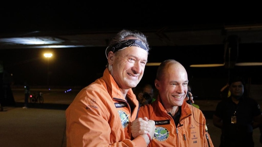 Swiss pilots and founders of Solar Impulse 2 Andre Boschberg, left and Bertrand Piccard pose for media before the Solar Impulse-2 took off from Ahmadabad, India, Wednesday, March 18, 2015. The solar powered aircraft is Wednesday headed to the northern Indian city of Varanasi on the third leg of its' historic round-the-world trip. (AP Photo/Ajit Solanki)
