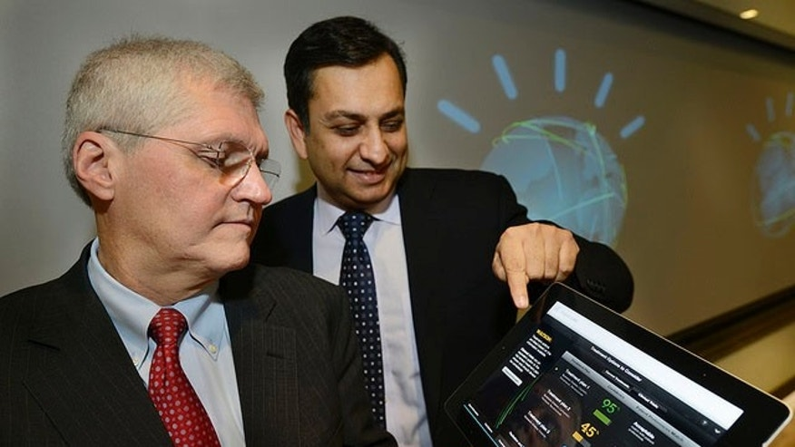 Mark Kris, MD, Chief of Thoracic Oncology, Memorial Sloan-Kettering Cancer Center (left) and Manoj Saxena, IBM General Manager, Watson Solutions (right) work with the first Watson-based cognitive computing solution for oncology.