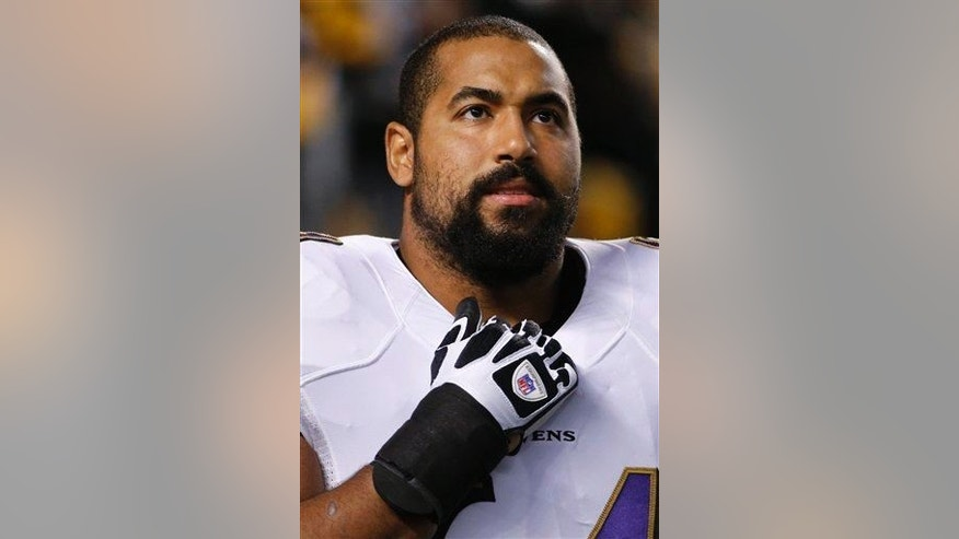Baltimore Ravens guard John Urschel (64) before an NFL football game against the Pittsburgh Steelers, Sunday, Nov. 2, 2014, in Pittsburgh.