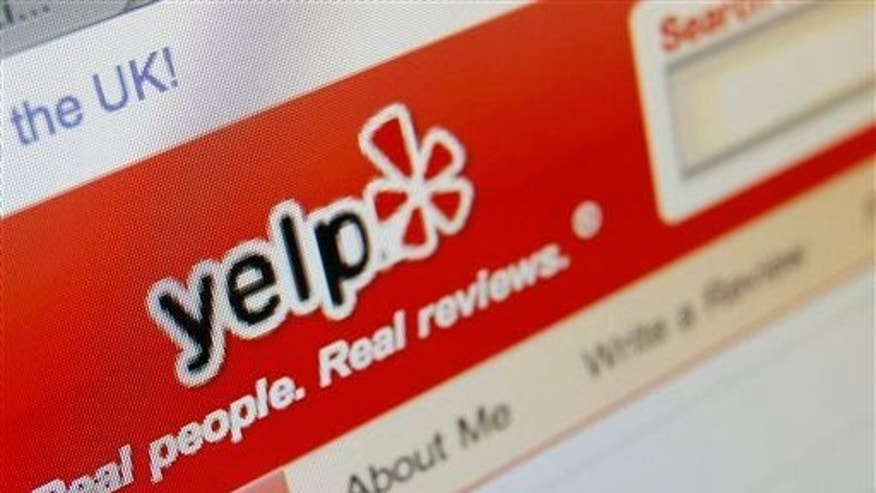 This March 17, 2010, file photo shows the Yelp website on a computer screen in Los Angeles.