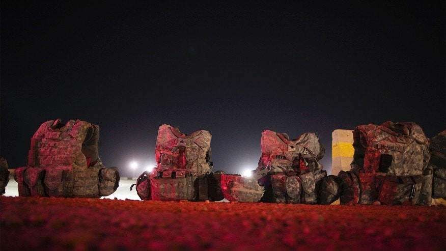 File photo - Sets of U.S. body armor rest on the ground near Nasiriyah, Iraq  Dec. 17, 2011.
