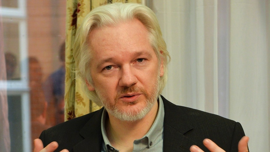 File photo - WikiLeaks founder Julian Assange gestures during a news conference at the Ecuadorian embassy in central London Aug. 18, 2014.