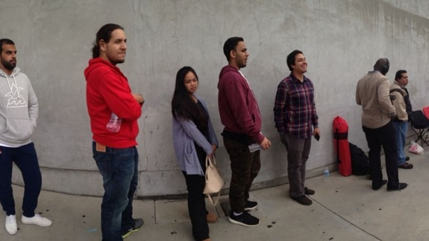 People wait in line to purchase the Apple Watch at aWest Hollywood store.