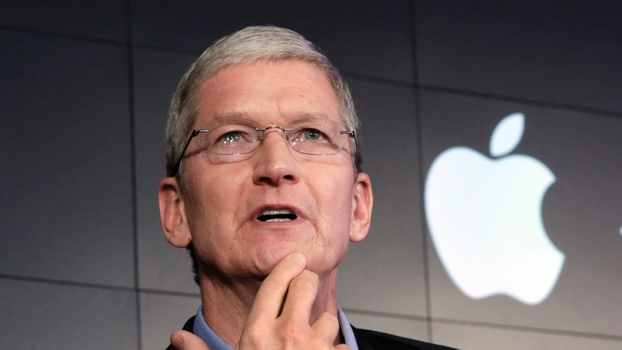 Apple CEO Tim Cook responds to a question during a news conference at IBM Watson headquarters, in New York, Thursday, April 30, 2015.