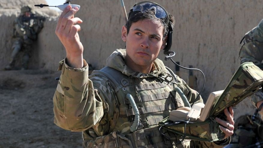 File photo - British Army Sergeant Scott Weaver, of The Queens Royal Lancers, launches a Black Hornet, Nano UAV from a compound in Afghanistan.