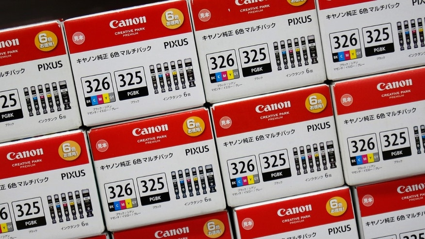 File photo - Canon's printer ink packages are pictured at an electronic shop in Tokyo Oct. 23, 2013.