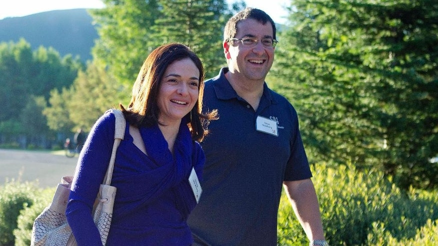 """FILE - In this July 6, 2011 file photo, Facebook COO Sheryl Sandberg, left, and her husband, David Goldberg, CEO of SurveyMonkey, arrive at the Sun Valley Inn for the Allen and Co. Sun Valley Conference, in Sun Valley, Idaho. Sandberg on Wednesday, June 3, 2015 took to her Facebook page to mark the end of a period of intense mourning following the May 1 death of her husband by saying """"I want to choose life and meaning."""" (AP Photo/Julie Jacobson, File)"""
