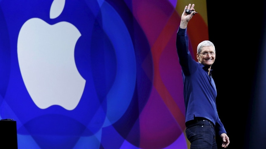 Apple CEO Tim Cook waves as he arrives on stage to deliver his keynote address at the Worldwide Developers Conference in San Francisco, Calif., June 8, 2015.