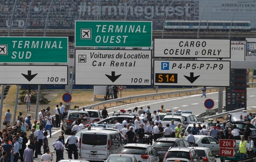 French striking taxi drivers block the access to Orly airport, south of Paris, France, during a national protest against car-sharing service Uber June 25, 2015.