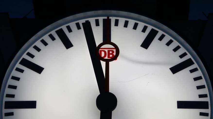 File photo - Deutsche Bahn sign is seen in a clock at a train station in Munich, Germany May 5, 2015.