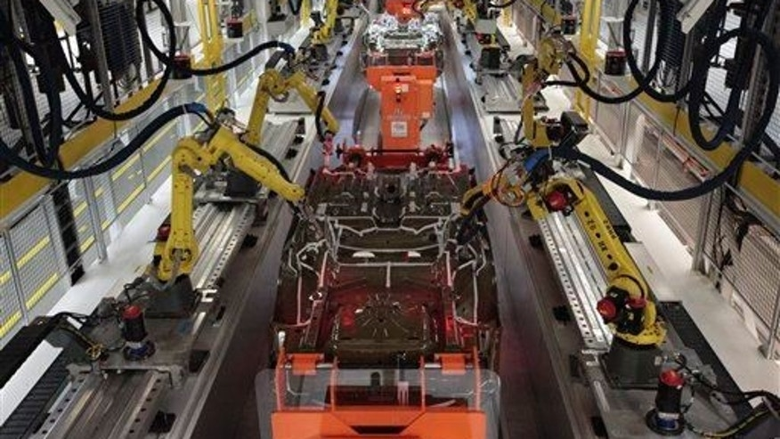 In this file photo, robots build automobiles on an assembly. It's not clear what type of machine was involved in the fatal accident.