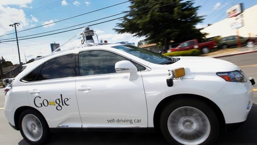 May 13, 2015: Google's self-driving Lexus car drives along street during a demonstration at Google campus in Mountain View, Calif.