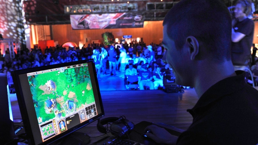 Aug 7, 2009: a participant plays a computer game during the Intel Friday Night Game, a competition of the ESL, Electronic Sports League, in Dresden, Germany.