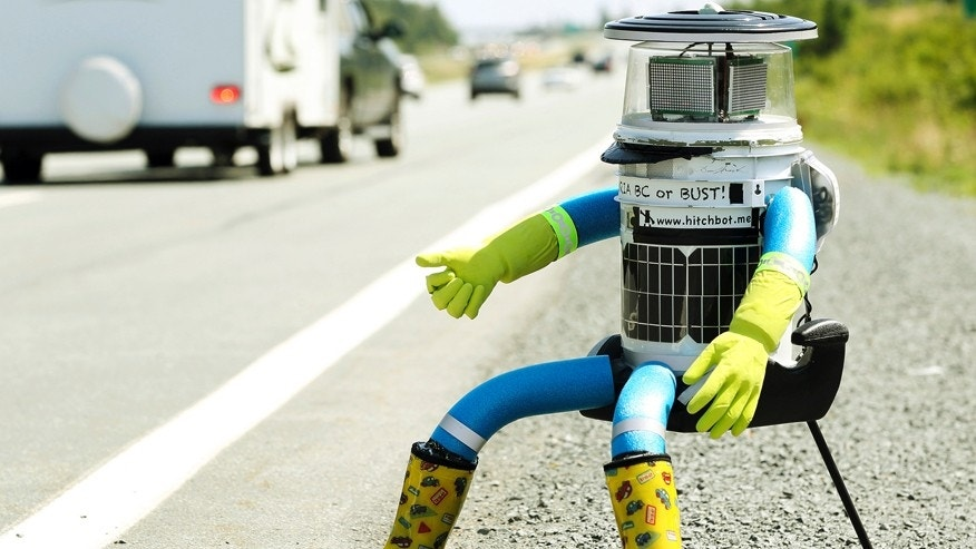 File photo - The anthropomorphic robot named hitchBOT sits on the shoulder of Highway 102 outside of Halifax, Nova Scotia, July 27, 2014.