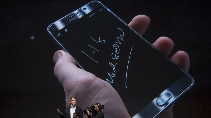 Vice President of Product Strategy and Marketing for Samsung Electronics America, Justin Denison, demonstrates a Samsung Galaxy Note 5 at the product's launch event in New York August 13, 2015.