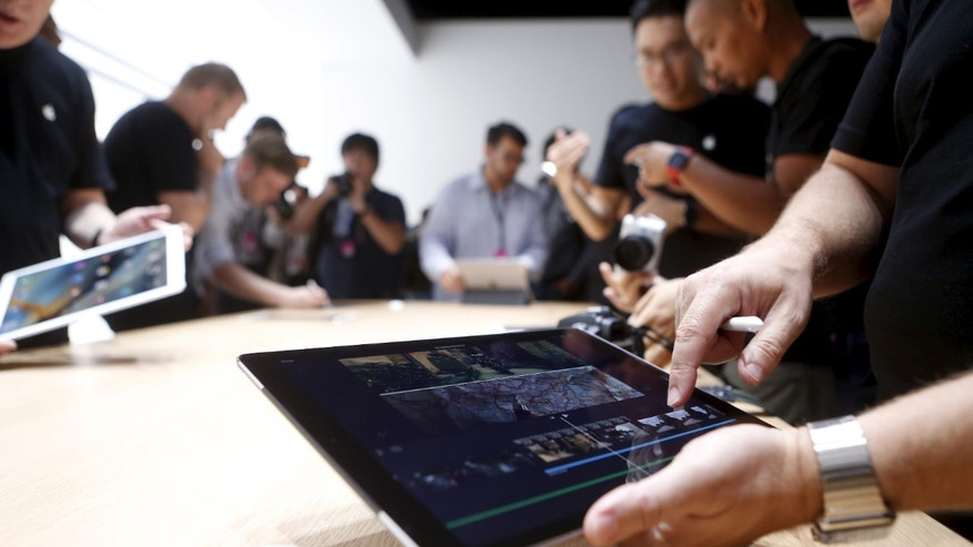 The new Apple iPad Pro is displayed during an Apple media event in San Francisco, California, September 9, 2015.