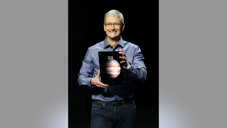 File photo - Apple CEO Tim Cook introduces the new iPad Pro during an Apple media event in San Francisco, Calif., Sept. 9, 2015.
