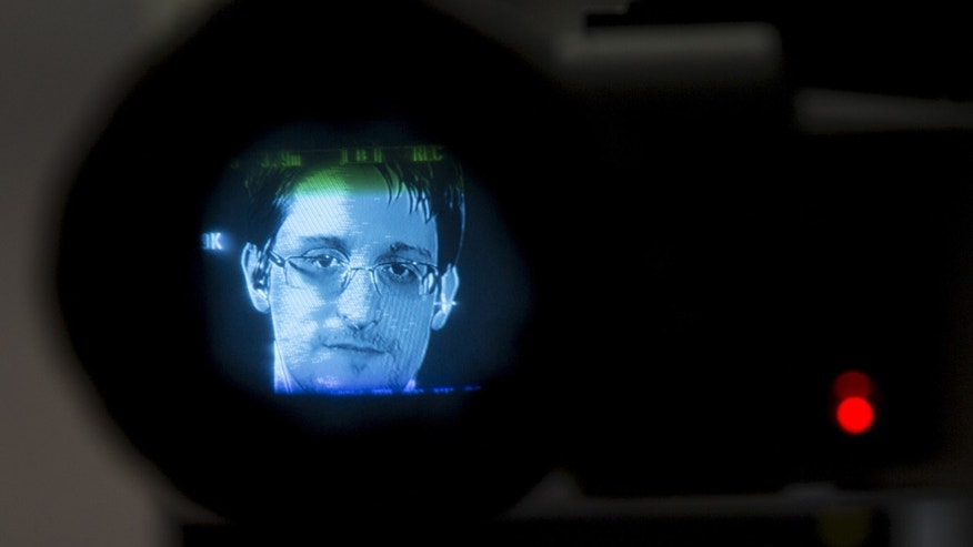 File photo - American whistleblower Edward Snowden is seen through a camera viewfinder as he delivers remarks via video link to attendees at a discussion regarding an International Treaty on the Right to Privacy, Protection Against Improper Surveillance and Protection of Whistleblowers in Manhattan, New York Sept. 24, 2015.