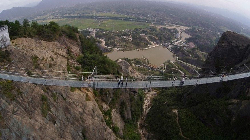 New glass suspension bridge in China is 980 feet long, 600 feet high, and absolutely terrifying