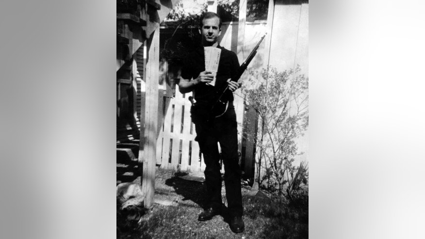 The famous backyard photo of Lee Harvey Oswald.