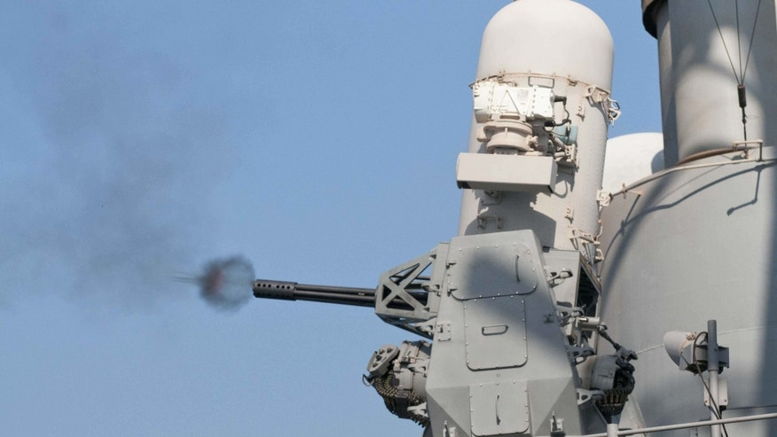 File photo - The guided-missile cruiser USS Hue City conducts a live-fire test of its Phalanx close-in weapons system (CIWS). (U.S. Navy photo by Mass Communication Specialist Seaman Darien G. Kenney/Released)