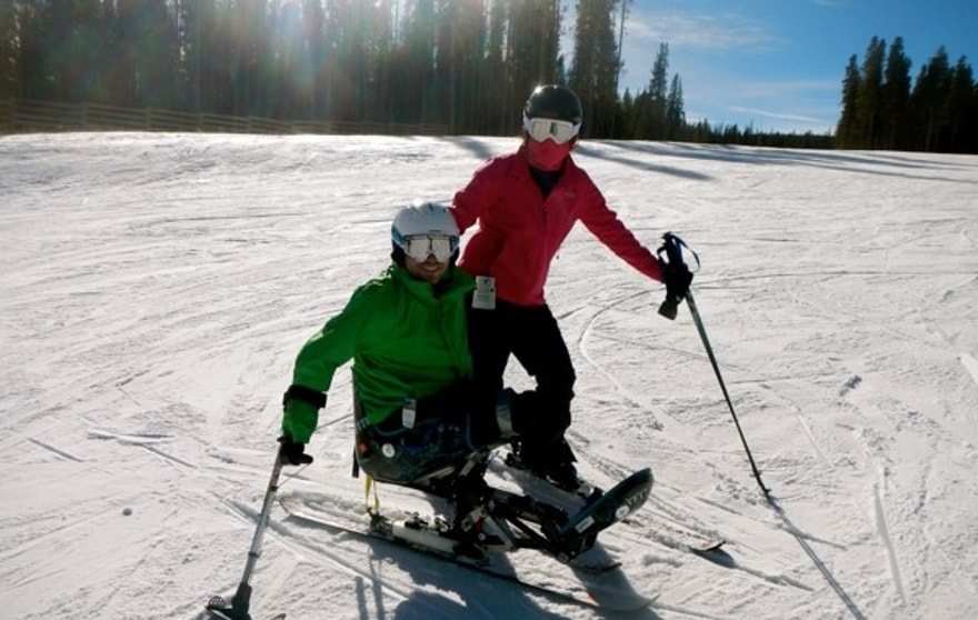 Travis Mills has 18 different prosthetic limbs, including a set that allows him to ski.