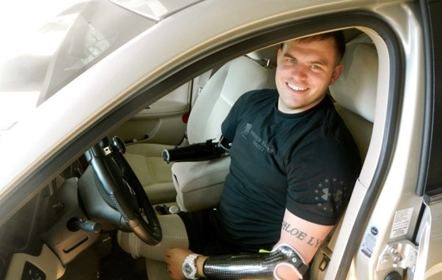 Thanks to his prosthetic limbs, Travis Mills can do many of the activities he once could including driving.