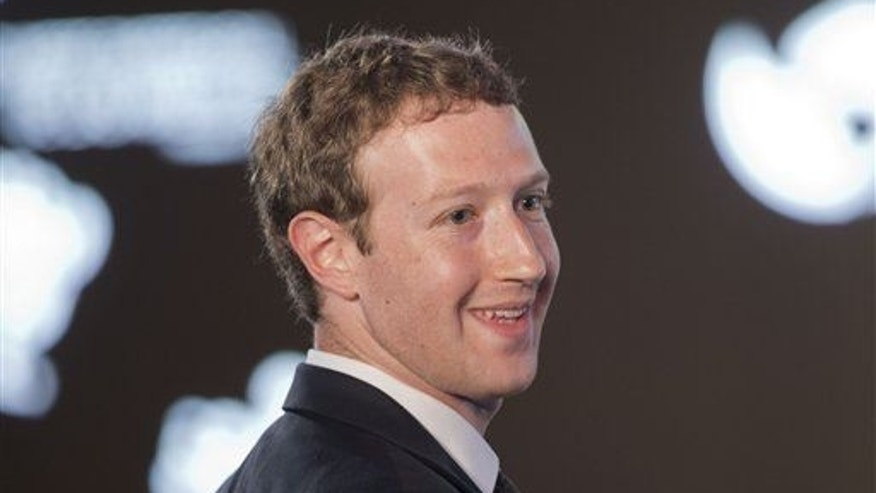 Facebook CEO Mark Zuckerberg asks a question during the CEO Summit of the Americas panel discussion in Panama City, Panama, April 10, 2015.