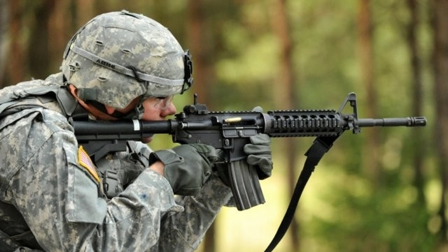Spc. Ethan Esposito, Joint Multinational Training Command, fires his M4 carbine rifle during United States Army Europe's Best Warrior Competition in Grafenwoehr, Germany, July 31, 2012. (U.S. Army)