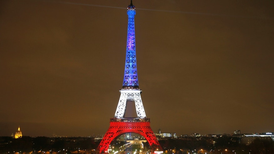The Eiffel Tower is lit with the blue, white and red colours of the French flag in Paris, France, Nov. 16, 2015, to pay tribute to the victims of a series of deadly attacks on Friday in the French capital. (REUTERS/Charles Platiau)