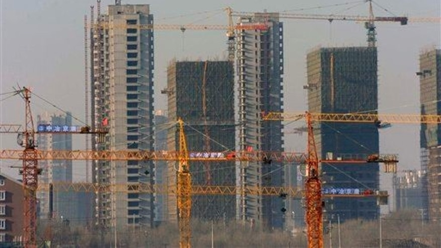 "A housing development under construction in Shenyang, China, in 2009. ""Ghost cities"" have sprung up around the country as developers struggle to fill units."