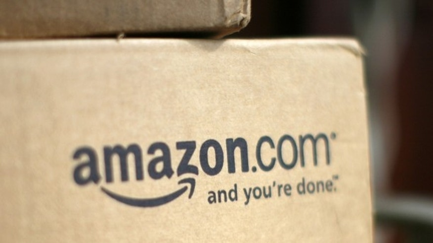 A box from Amazon.com is pictured on the porch of a house in Golden, Colorado in this July 23, 2008 file photograph.