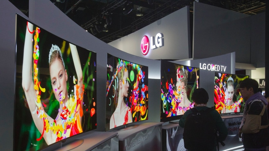 Curved 4K OLED televisions are displayed at the LG Electronics booth during the 2014 International Consumer Electronics Show at Las Vegas Convention Center in Las Vegas, Nevada.