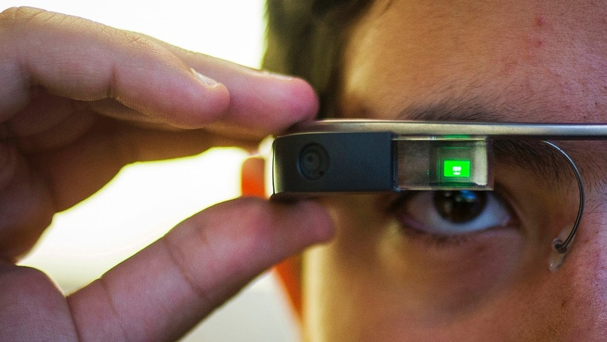 File photo - Tiago Amorim of Brazil, poses with a Google Glass eyewear frame in Manhattan, New York Sep. 19, 2014.