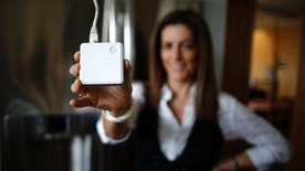 Computer science professor Christa Lopes holds an appliance communication module attached to the refrigerator in her home in Irvine, California January 26, 2015. Lopes said the Irvine Smart Grid Demonstration, a $79 million project funded half by federal stimulus money and half by Edison and partners like UC Irvine, cut her electric bill to zero in the summer. The $12 billion utility's research team Southern California Edison is testing everything from charging electronic vehicles via cell phone to devices that smooth out the power created by rooftop solar panels. Those are some of the roughly 60 projects in the works at Edison's Advanced Technology division. It has a small $19 million annual budget, but its influence far exceeds that. Picture taken January 26, 2015.        To match feature EDISON-LABS/       REUTERS/Lucy Nicholson (UNITED STATES - Tags: ENERGY BUSINESS) - RTR4N6PC