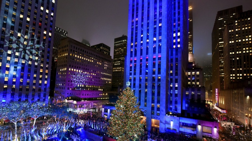 File photo - The Rockefeller Center Christmas Tree is lit at the 83rd Annual Rockefeller Center Christmas Tree Lighting Ceremony, Wednesday, Dec. 2, 2015 in New York. (AP)