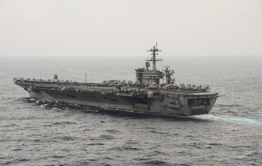 The aircraft carrier USS Theodore Roosevelt (CVN 71) transits the South China Sea in this U.S. Navy picture taken October 29, 2015. U.S. Secretary of Defense Ash Carter will visit the Roosevelt as it transits the South China Sea on Thursday, a move sure to raise the ire of China as tensions between Washington and Beijing simmer over the disputed waterway.  Picture taken October 29, 2015.  REUTERS/U.S. Navy/Mass Communications Specialist 3rd Class Anthony N. Hilkowski/Handout via Reuters - RTX1UT39