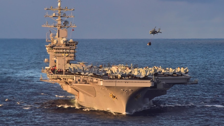 File photo - An MH-60S Sea Hawk helicopter delivers cargo to the aircraft carrier USS Dwight D. Eisenhower (CVN 69) (U.S. Navy photo by Mass Communication Specialist 3rd Class Jameson E. Lynch/Released)