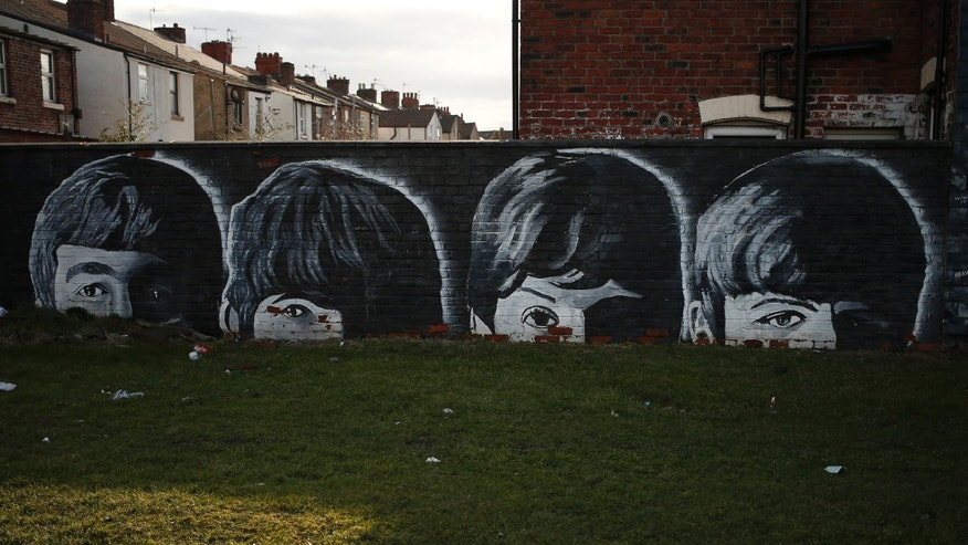 File phtoo - A mural of the Beatles is seen painted on the end of a row of terraced houses in Liverpool, northern England Feb. 18, 2015. (REUTERS/Phil Noble)