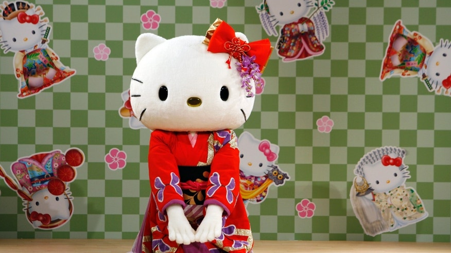 """File photo - A performer dressed as a Hello Kitty masot wearing a kimono performs a classical Japanese dance at a event named """"Let's learn Japanese culture with Hello Kitty"""" at Tamagawa Takashimaya shopping center in Tokyo Sept. 2, 2007. (REUTERS/Toru Hanai)"""